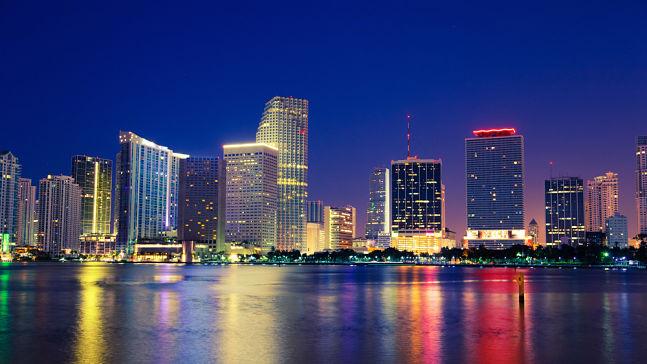 Miami city skyline at night, Miami Interpreter Services