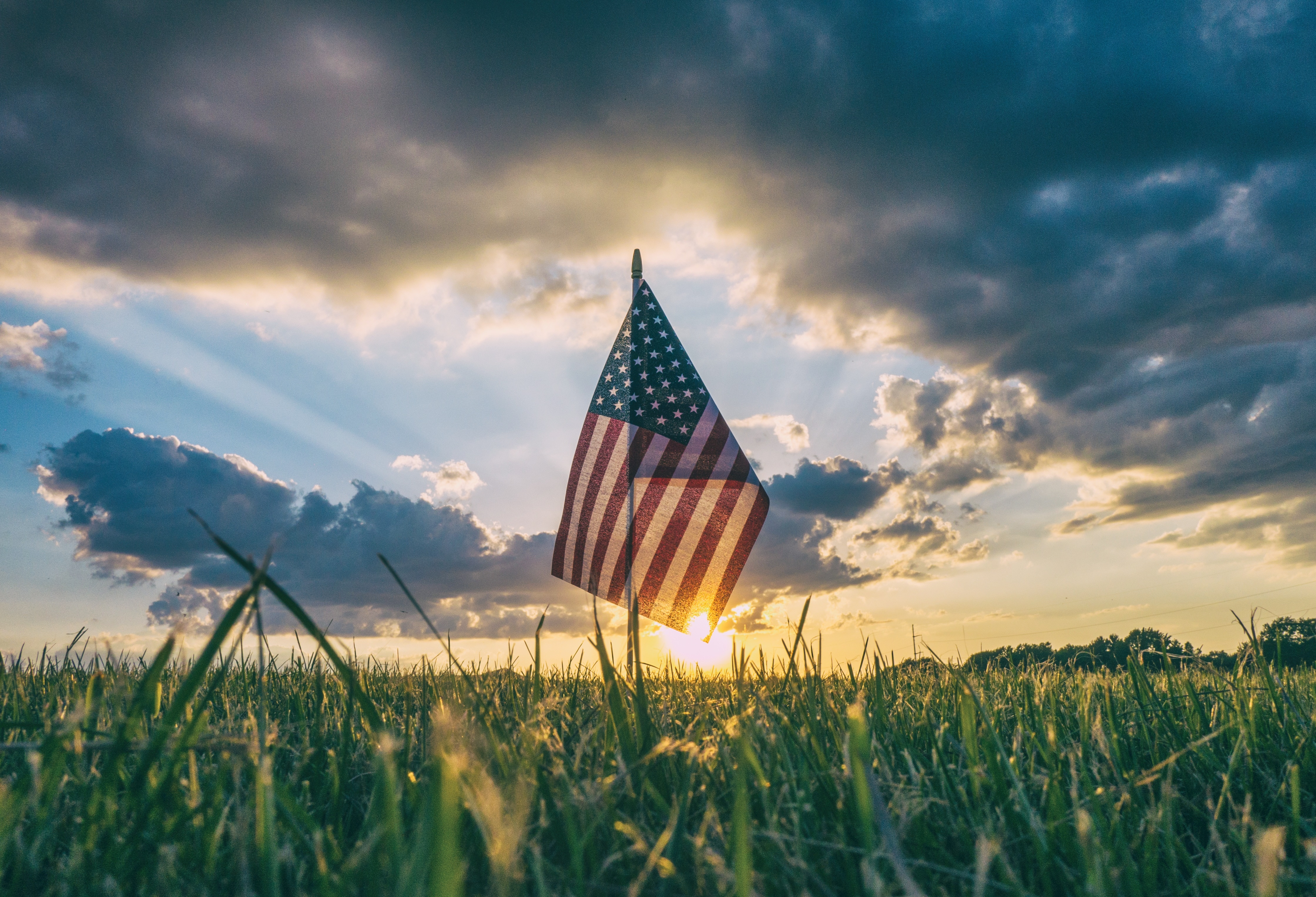 The American Flag in a valley with the sunset, The Spirit of Independence Day